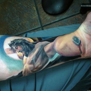 Colored 3D Crucufied Jesus Forearm Tattoo