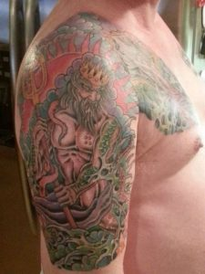 Colored Green-Scaled Neptune Arm Sleeve Tattoo