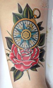 Colored Nautical Compass on a Red Rose Forearm Tattoo