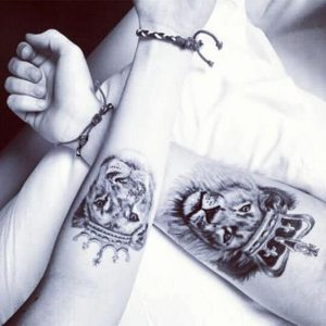 Crowned Lion And Lioness Forearm Tattoo