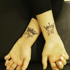 Crowns With Names Underneath Wrist Tattoos