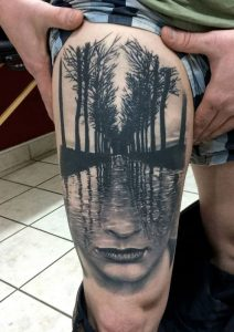 Face and Vanishing Point Surrealism Thigh Tattoo