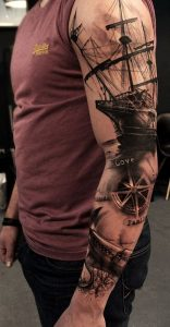 Full Sleeve Tattoo of a Galleon and a Nautical Compass