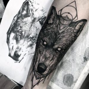 Geometric Rendition of a Wolf on Forearm Tattoo