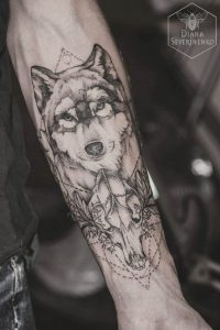 Geometric Wolf with its Skull Forearm Tattoo