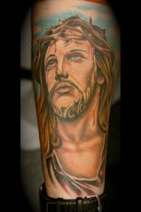 Golden Haired Jesus with Crown of Thorns Forearm Tattoo