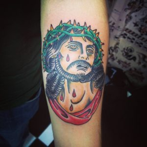 Green Thorns with Dripping Blood Jesus Forearm Tattoo