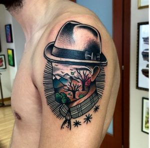 Man with Hat Surrealism Arm Tattoo