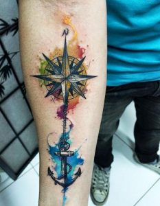 Nautical Compass Anchored with Watercolor Splashes Forearm Tattoo