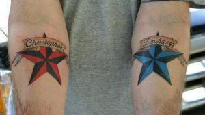 Red And Blue Nautical Stars Forearm Tattoos