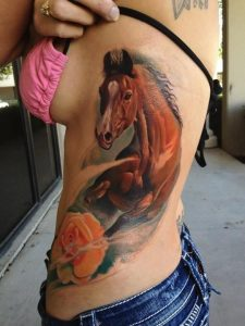 Running Brown Horse on Yellow Flower Side Tattoo