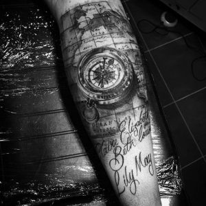 Shaded Compass on Old Map with Dedication Half Sleeve Tattoo