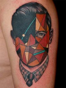 Shattered Glass Man Face Surrealism Arm Tattoo