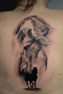 Solid Black with Horse Spirit Spine Tattoo