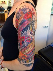 Two Red and Black Kois Half Sleeve Tattoo