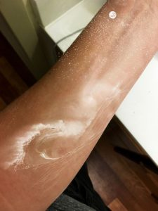 White Ink Wave Forearm Tattoo