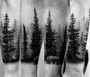 A Bear in a Forest Sleeve Tattoo