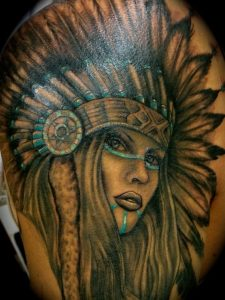 Blue-Outlined Woman with Headdress Arm Tattoo