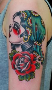 Crying Gypsy with Large Red Rose Arm Tattoo