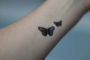 Detailed Butterfly Tattoos on Arm