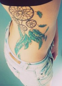 Dreamcatcher Side Tattoo with Bluish Feathers
