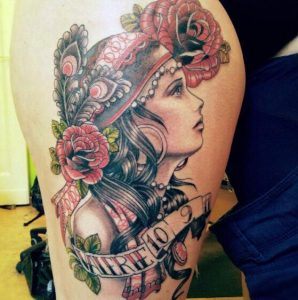 Gypsy with Expressive Face Thigh Tattoo