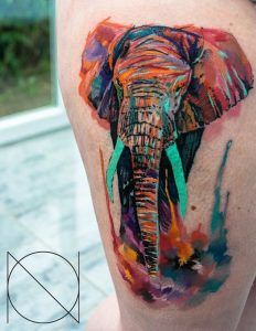 Intensed Watercolor Elephant Arm Tattoo