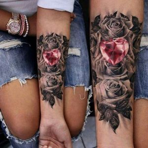 Monochromatic Roses with Heart-Shaped Ruby Forearm Tattoo