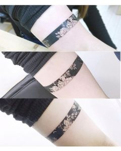 Negative Space Flowers Arm Band Tattoo