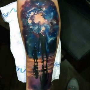 Night Sky Over Silhouetted Man and Child Arm Tattoo
