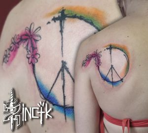 Peace Sign with Small Watercolor Flower Upper Back Tattoo