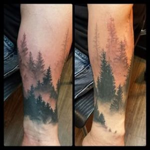 Pine Forest on Negative Space Forearm Sleeve Tattoo