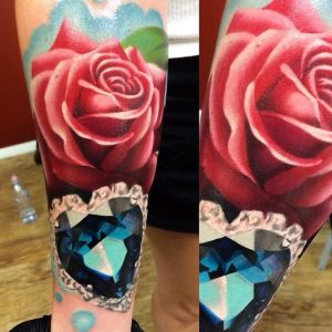 Realistic Rose and Heart-Shaped Sapphire Forearm Tattoo