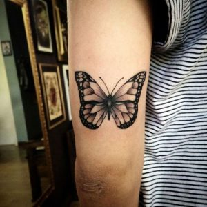 Shaded Butterfly Arm Tattoo