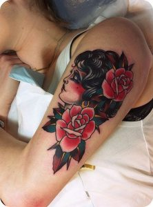 Side View of a Gypsy with Roses Arm Tattoo