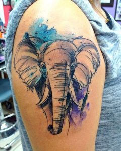 Sketchy Elephant on Blue-Violet Watercolor Background Arm Tattoo