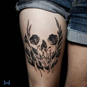 Skull on Floral Negative Space Thigh Tattoo