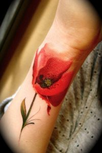 Smudged Red Watercolor Flower Wrist Tattoo