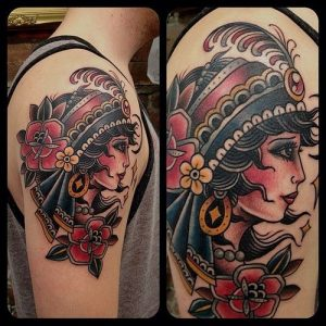 Sparkling Gypsy with a Feathered Headdress Arm Tattoo