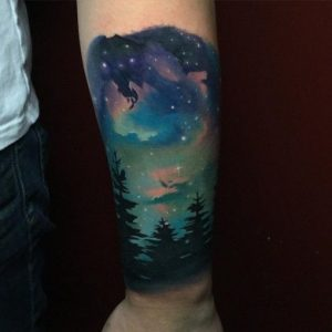 Starry Night Sky Over Forest Forearm Sleeve Tattoo
