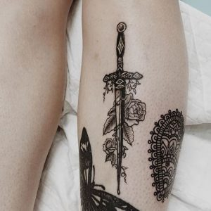 Thin Dagger with Roses Forearm Tattoo