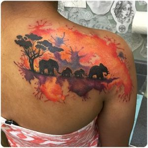 Watercolor Background of an Elephant Family Upper Back Tattoo