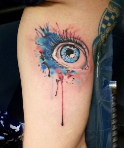 Watercolor Blue Eyes Arm Tattoo