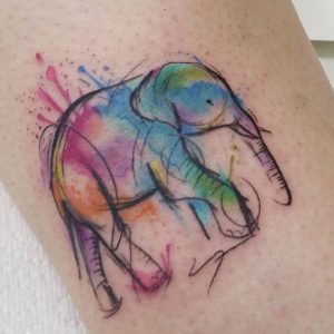 Watercolor-Splashed Sketchy Elephant Arm Tattoo