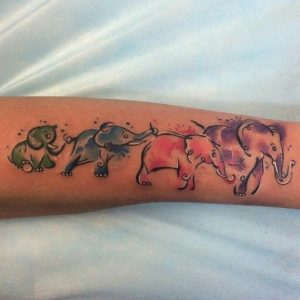 Watercolored Baby Elephants in Line Arm Tattoo
