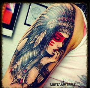 Woman with Closed Eyes on Indian Headdress Arm Tattoo