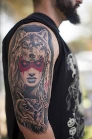 Woman with Painted Face on Headdress Arm Tattoo