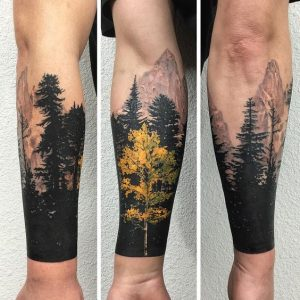 Yellow Tree Infront of a Silhouette Nature Sleeve Tattoo