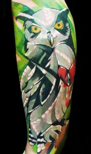 Abstract Gray Owl Over Tropical Background Arm Tattoo