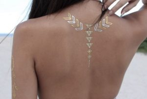 Arrowheads and Triangles Spine Tattoo
